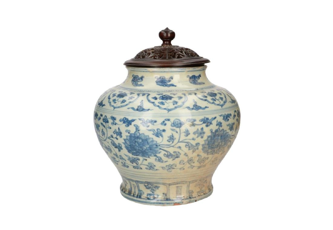 A blue and white porcelain vase with floral decor. - 2