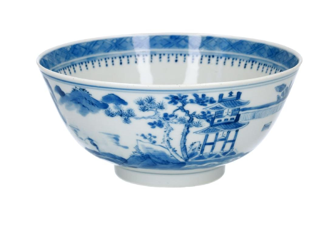 A blue and white porcelain bowl, decorated with river