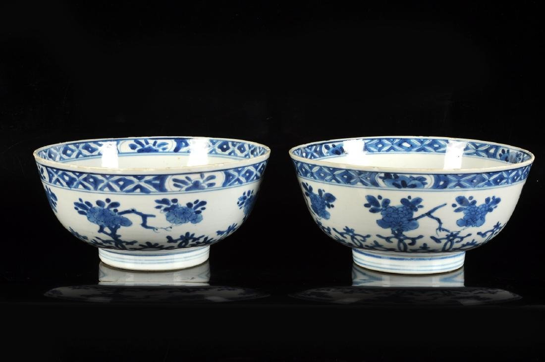 A pair of blue and white porcelain bowls with floral