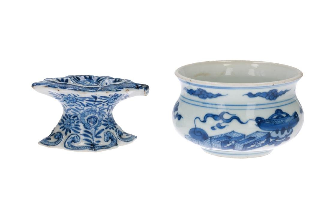 A blue and white porcelain salt cellar in the shape of
