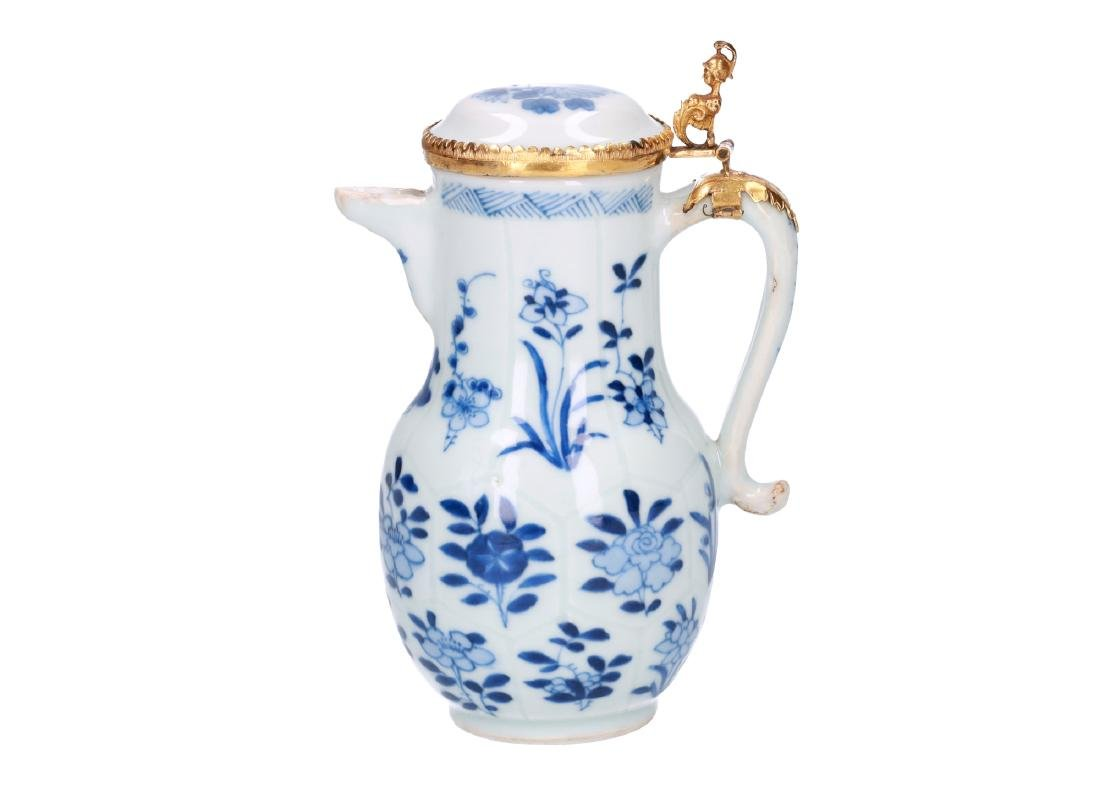 A blue and white porcelain milk jug decorated with
