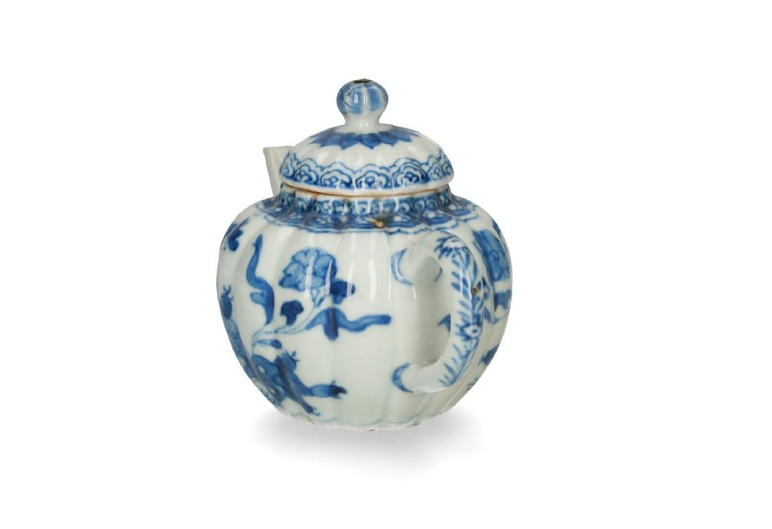 A blue and white porcelain lobbed teapot with floral