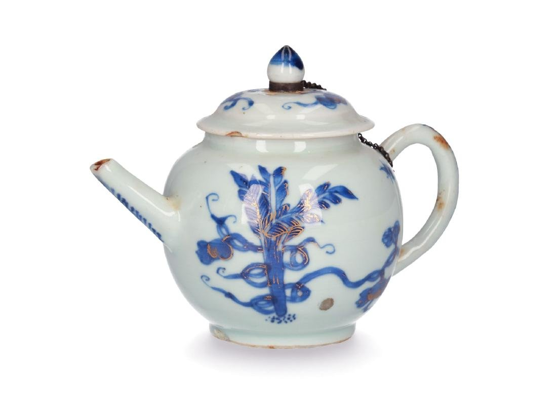 A blue and white porcelain teapot with partly gilt