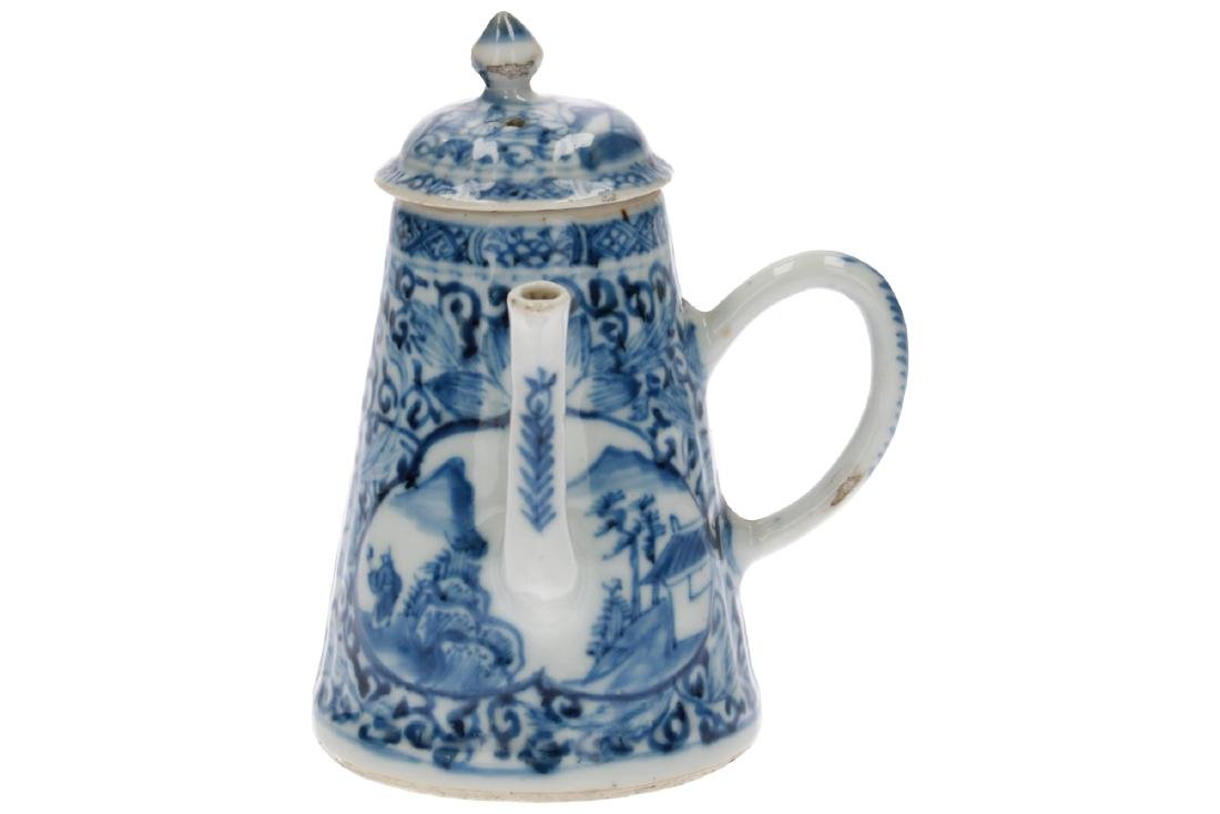 A blue and white porcelain teapot with the handle to