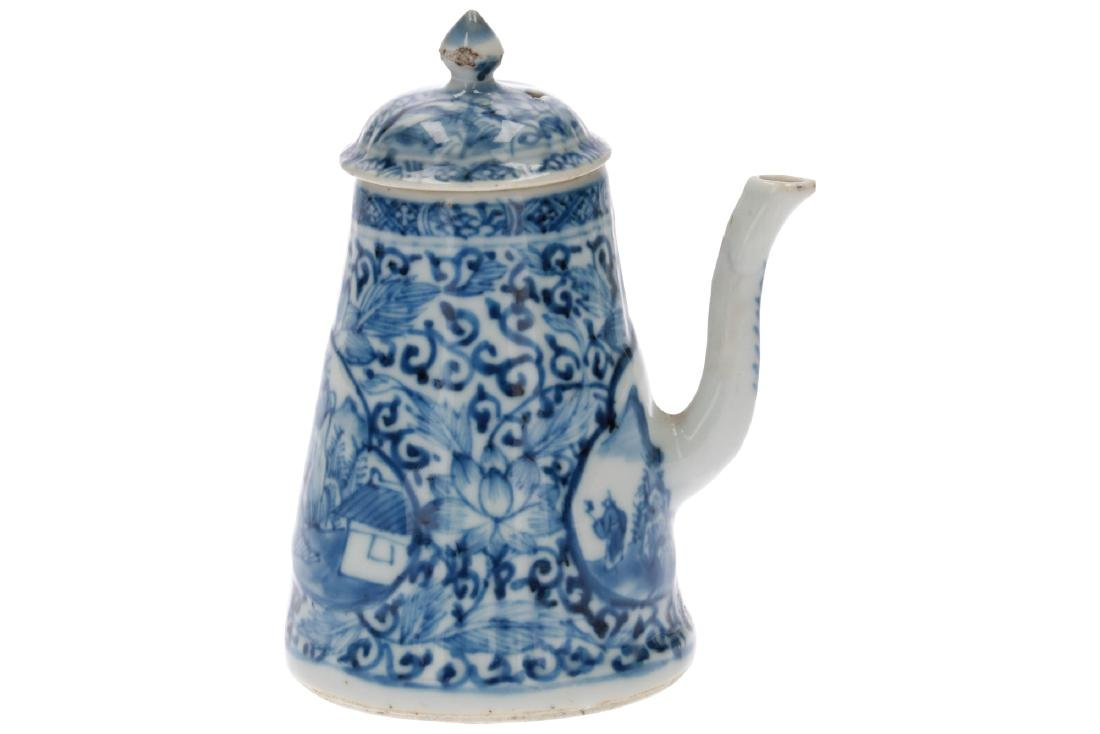 A blue and white porcelain teapot with the handle to - 4