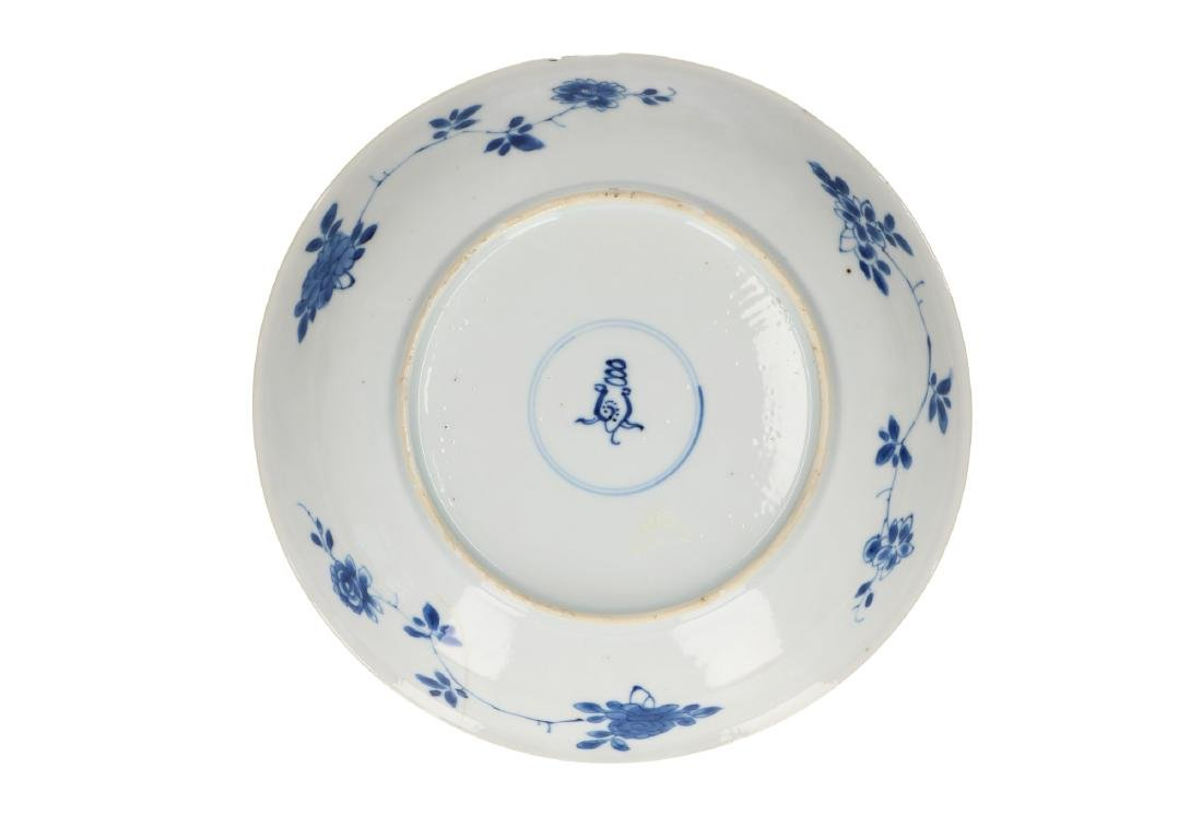 A blue and white porcelain dish with decor of lotus and