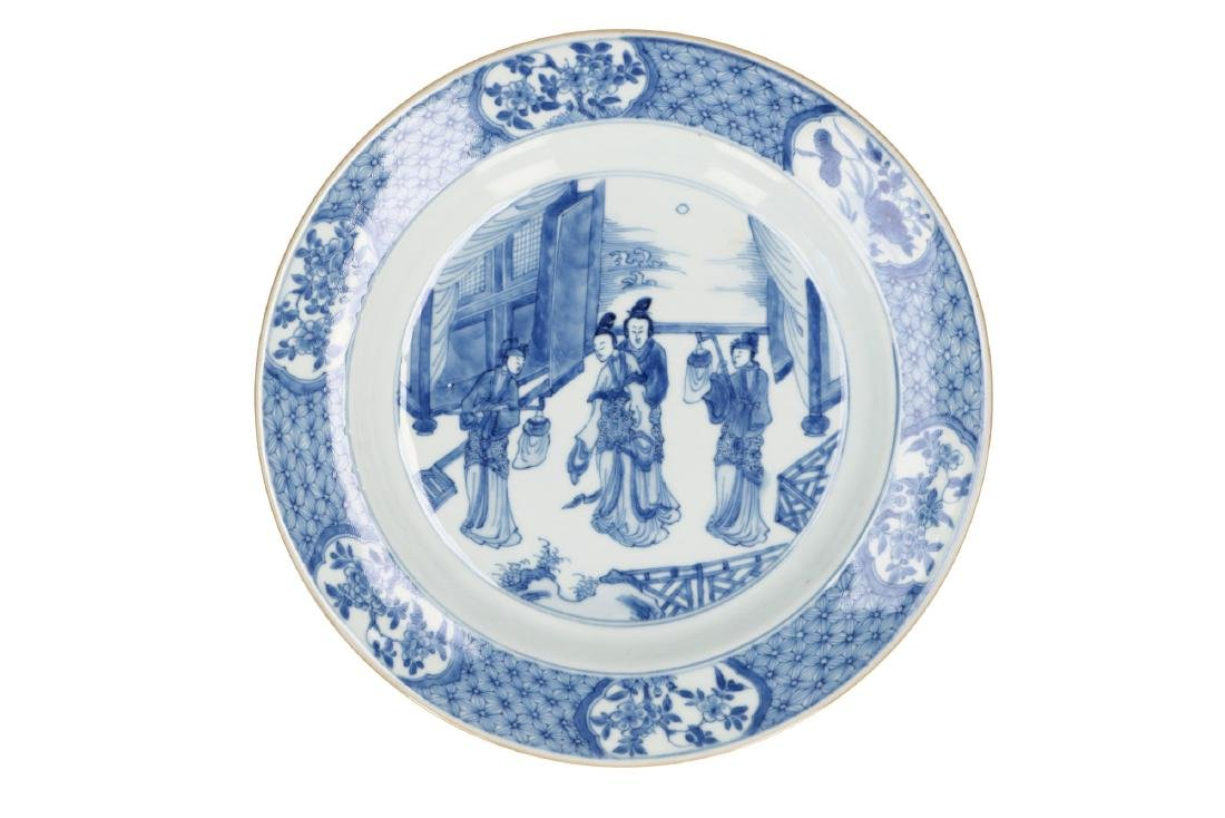 A blue and white porcelain dish, decorated with elegant