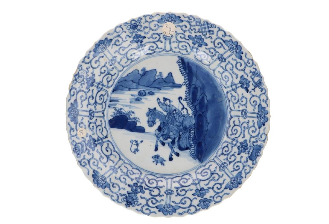 A blue and white porcelain dish with scaloped rim,