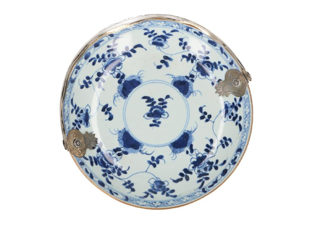 A blue and white porcelain dish with floral decor and