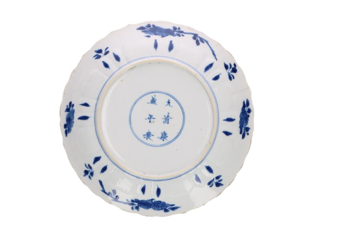 A blue and white porcelain dish with panels and floral