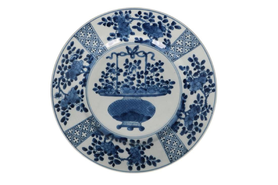 A set of three blue and white porcelain plates, with