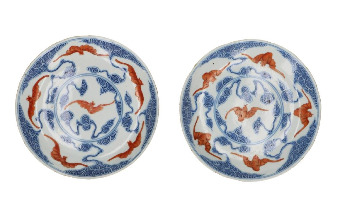 A pair of polychrome porcelain dishes decorated with