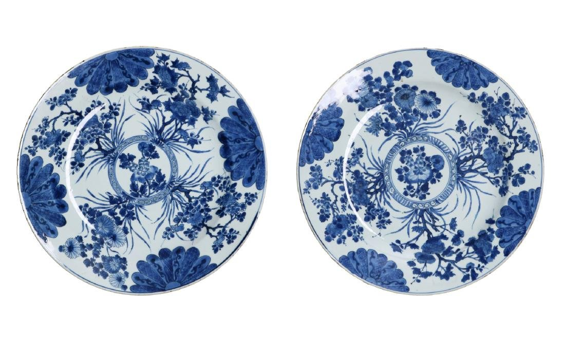 A set of two blue and white porcelain chargers