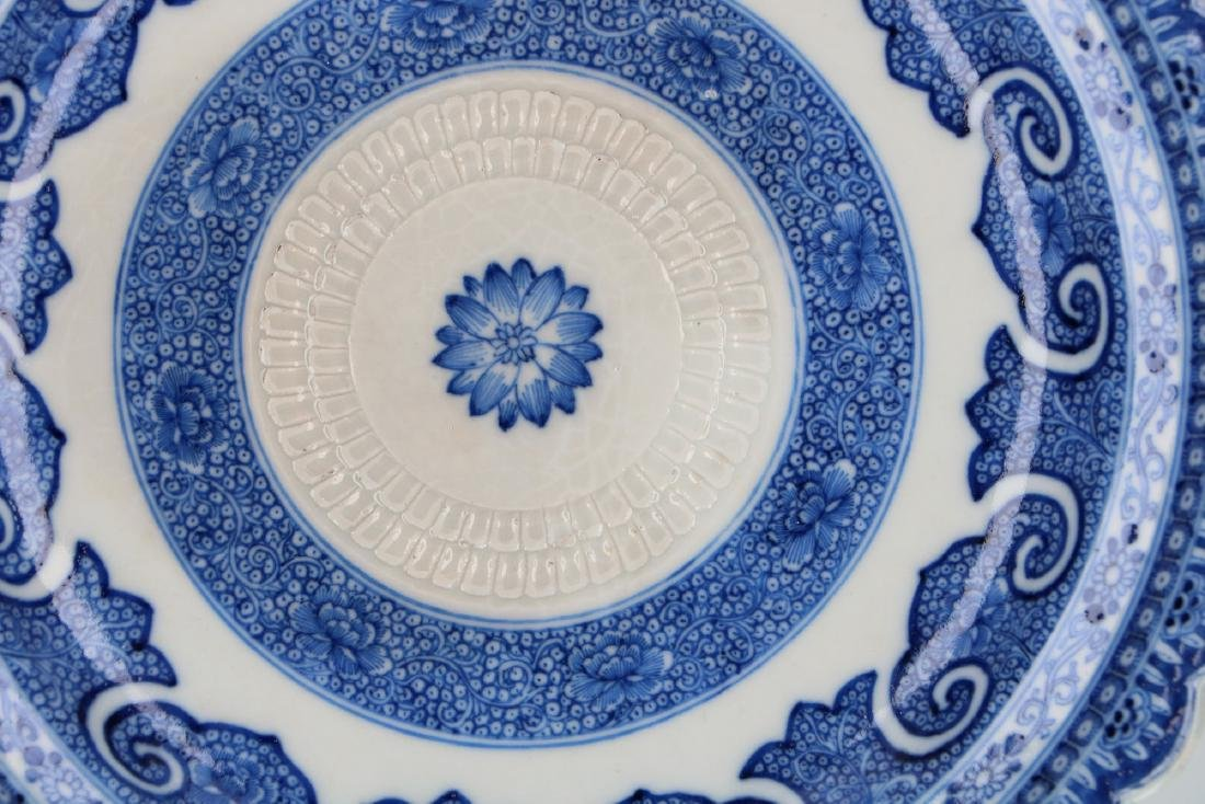 A blue and white porcelain dish with scalloped rim and - 2