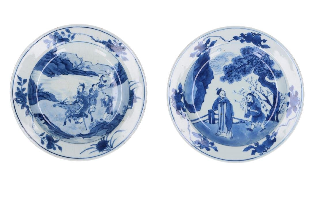 A lot of two blue and white porcelain dishes, decorated