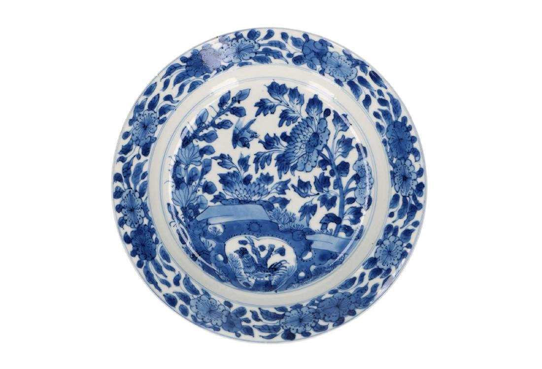 A blue and white porcelain dish with rare decor of