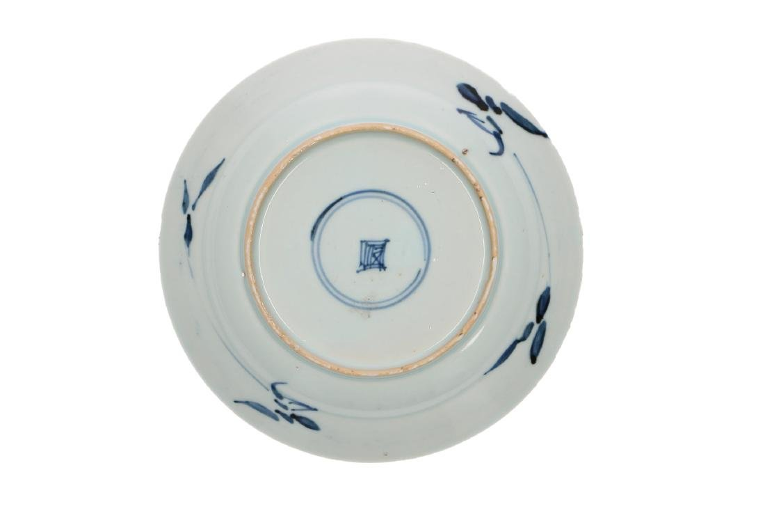 A blue and white porcelain saucer, decorated with a