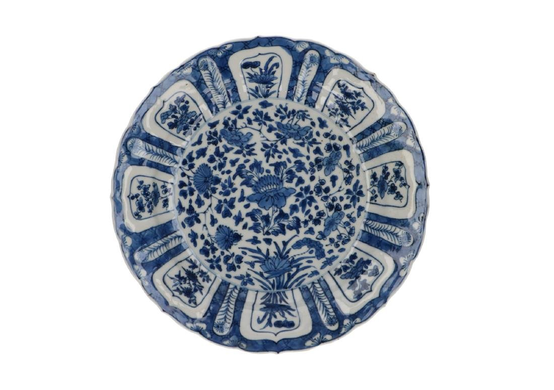 A pair of blue and white porcelain dishes with floral