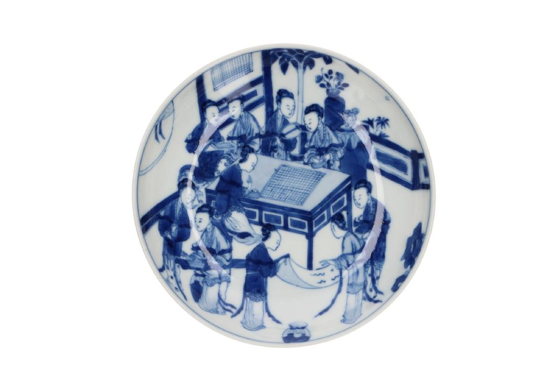 A pair of blue and white porcelain saucers with an