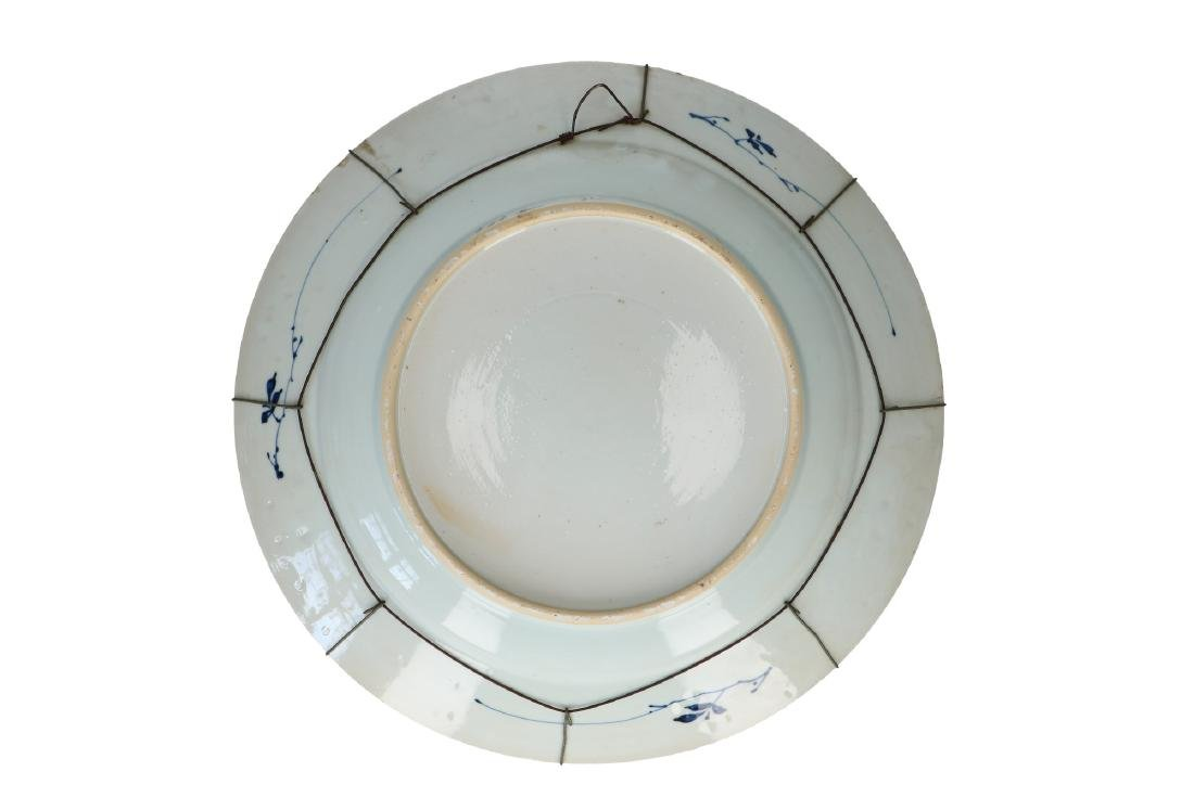 A blue and white porcelain charger with floral decor