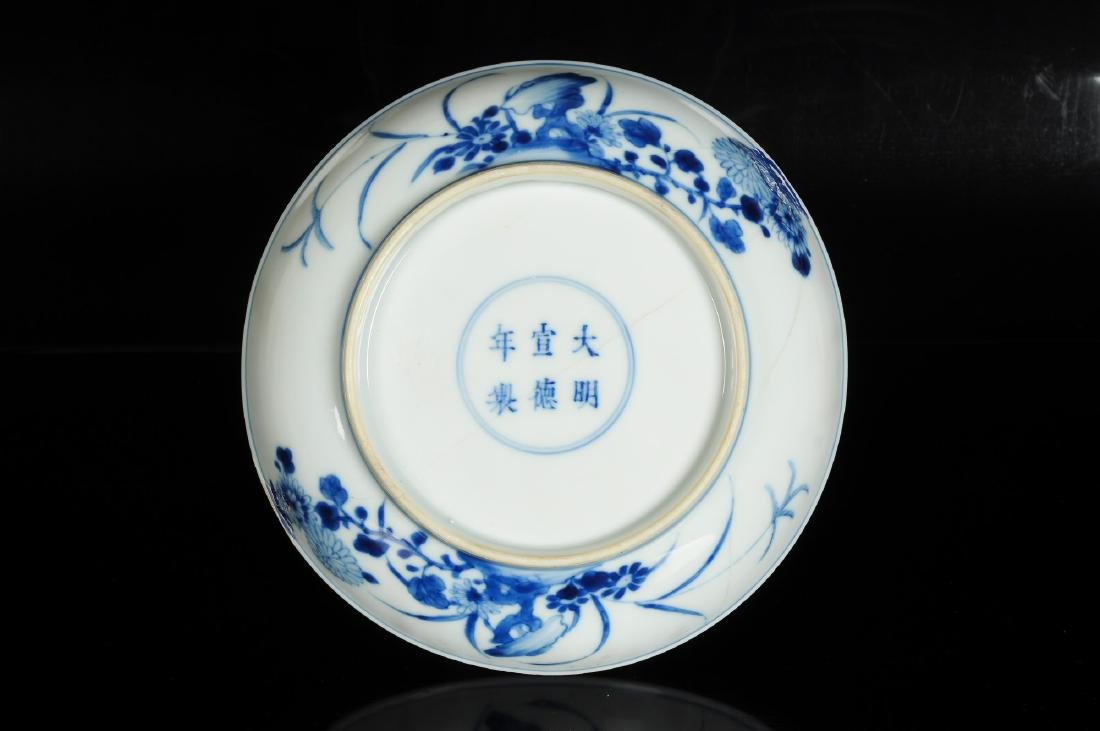 A blue and white porcelain dish with a decor of elegant - 4
