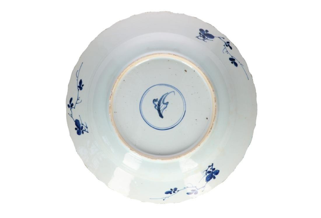 A blue and white porcelain charger with floral decor.