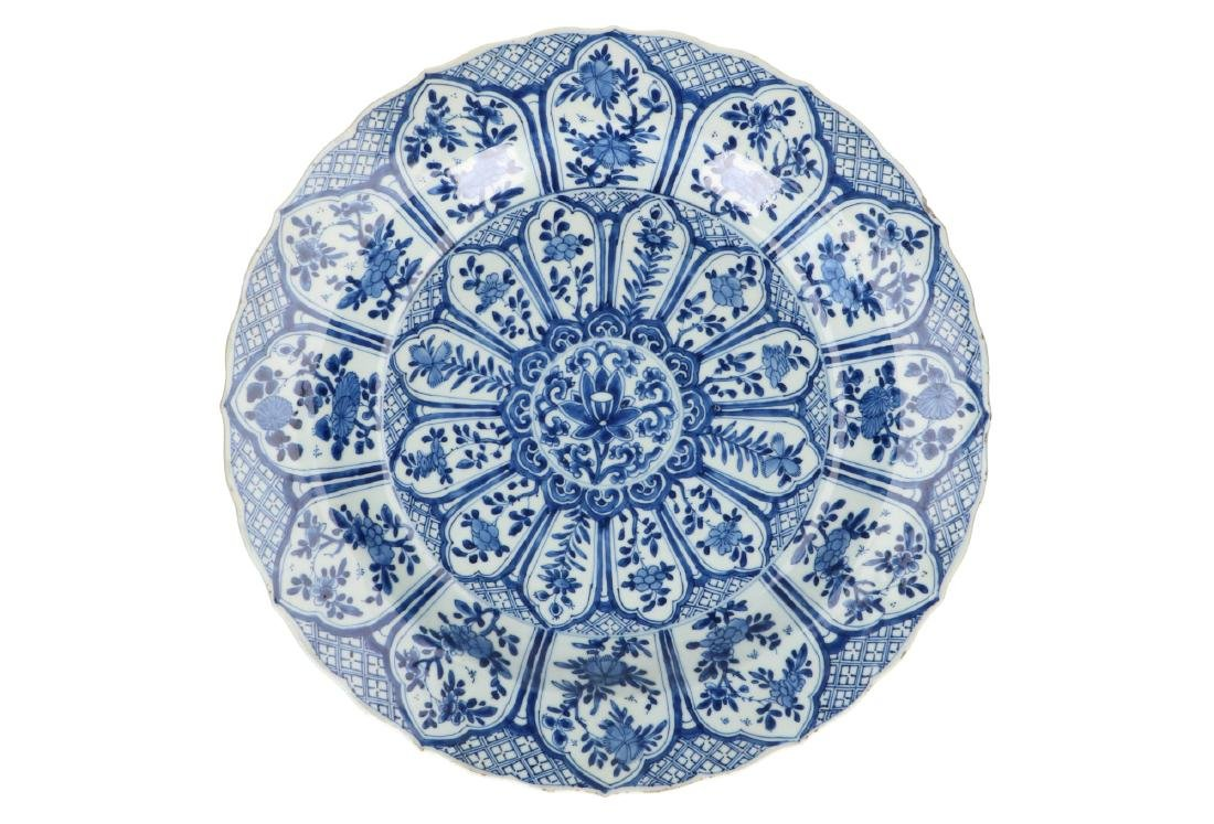 A blue and white porcelain charger with floral decor. - 2