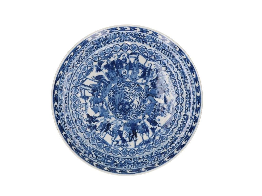 A blue and white porcelain dish decorated with several