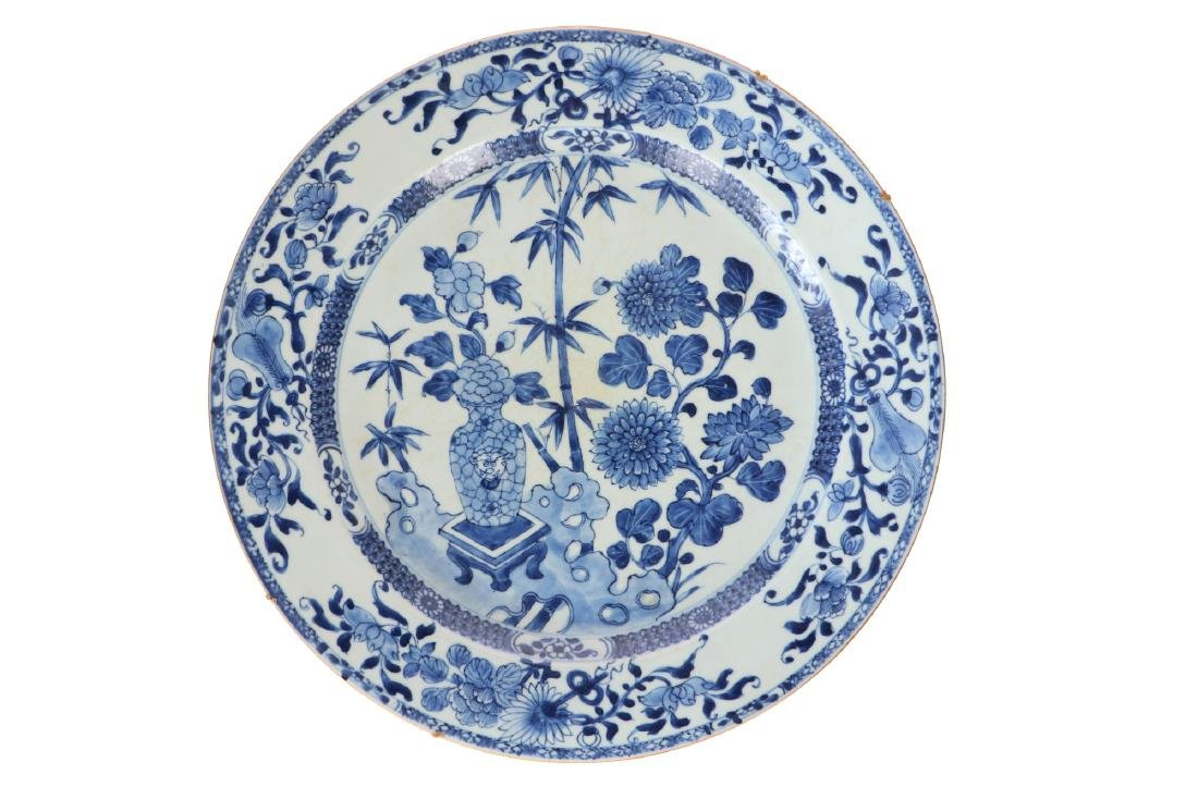 A large blue and white porcelain charger decorated with