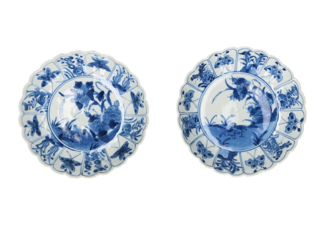 A pair of blue and white porcelain lobbed deep saucers