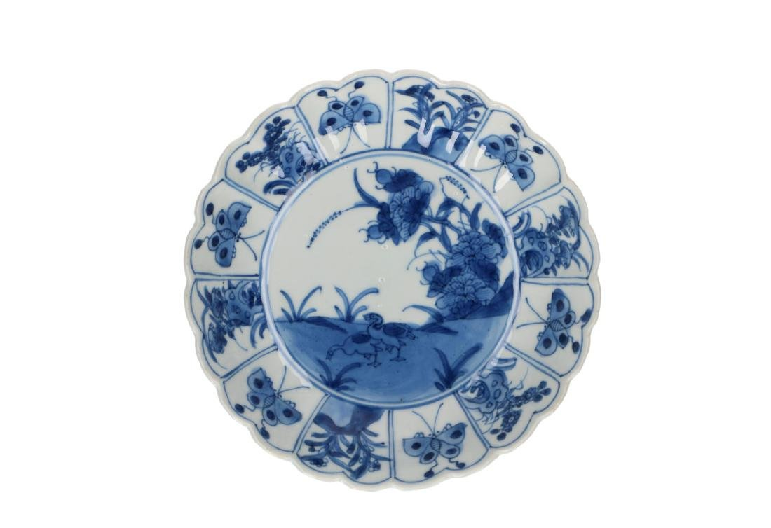 A pair of blue and white porcelain lobbed deep saucers - 2