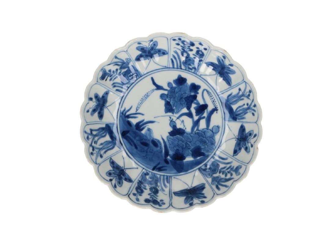 A pair of blue and white porcelain lobbed deep saucers - 3