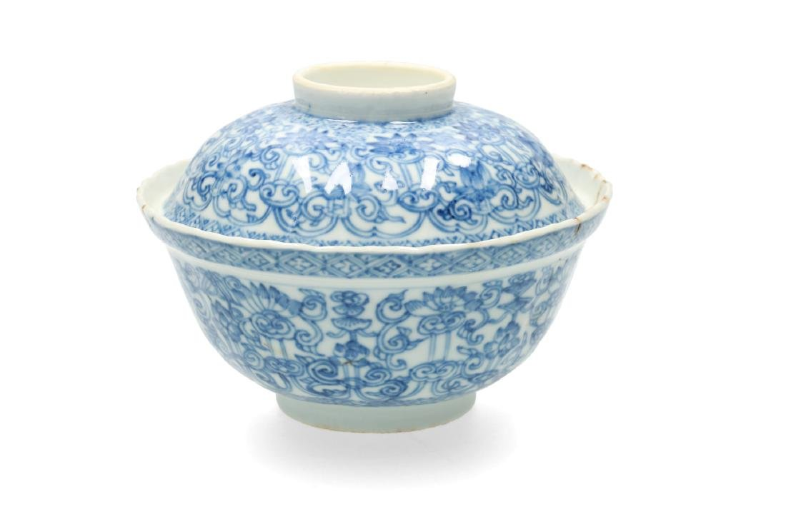 A blue and white porcelain lidded bowl with geometric