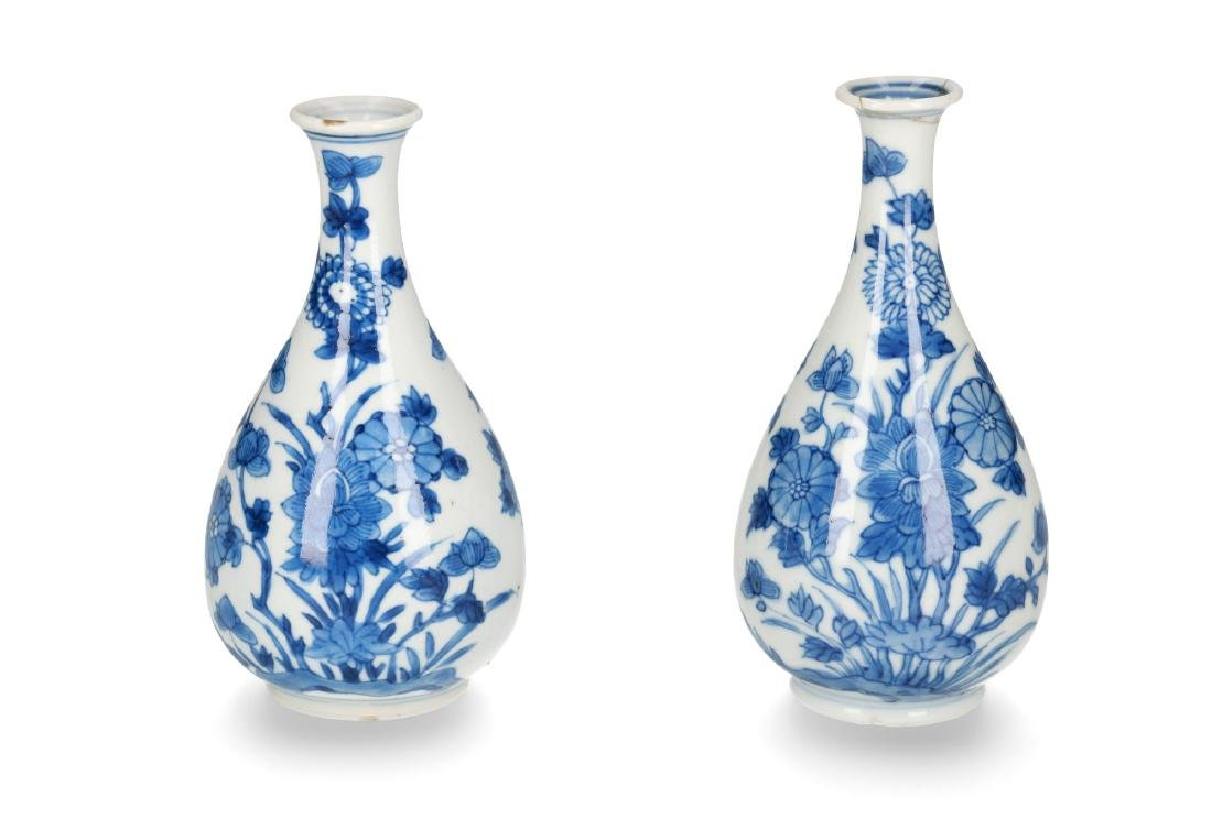 A pair of blue and white porcelain vases with floral
