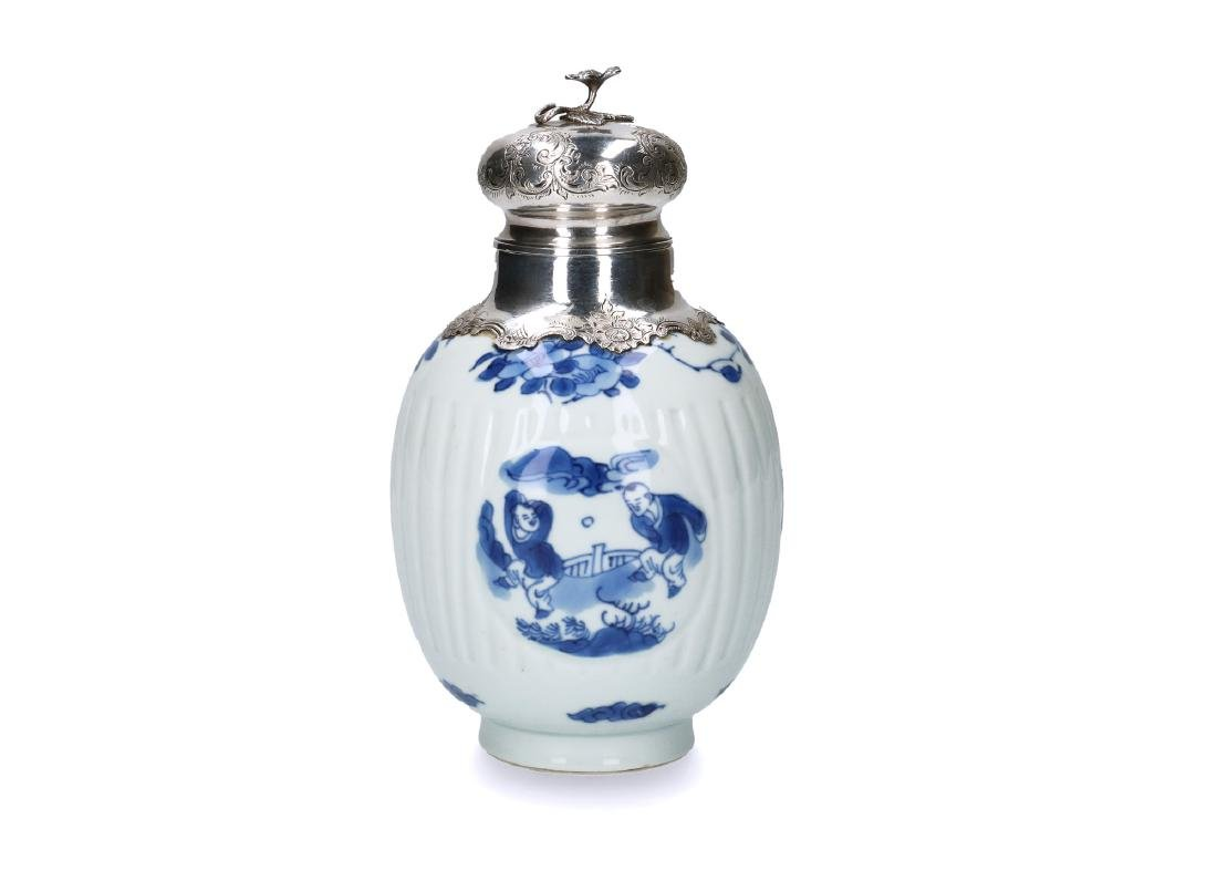 A blue and white porcelain ginger jar converted to a