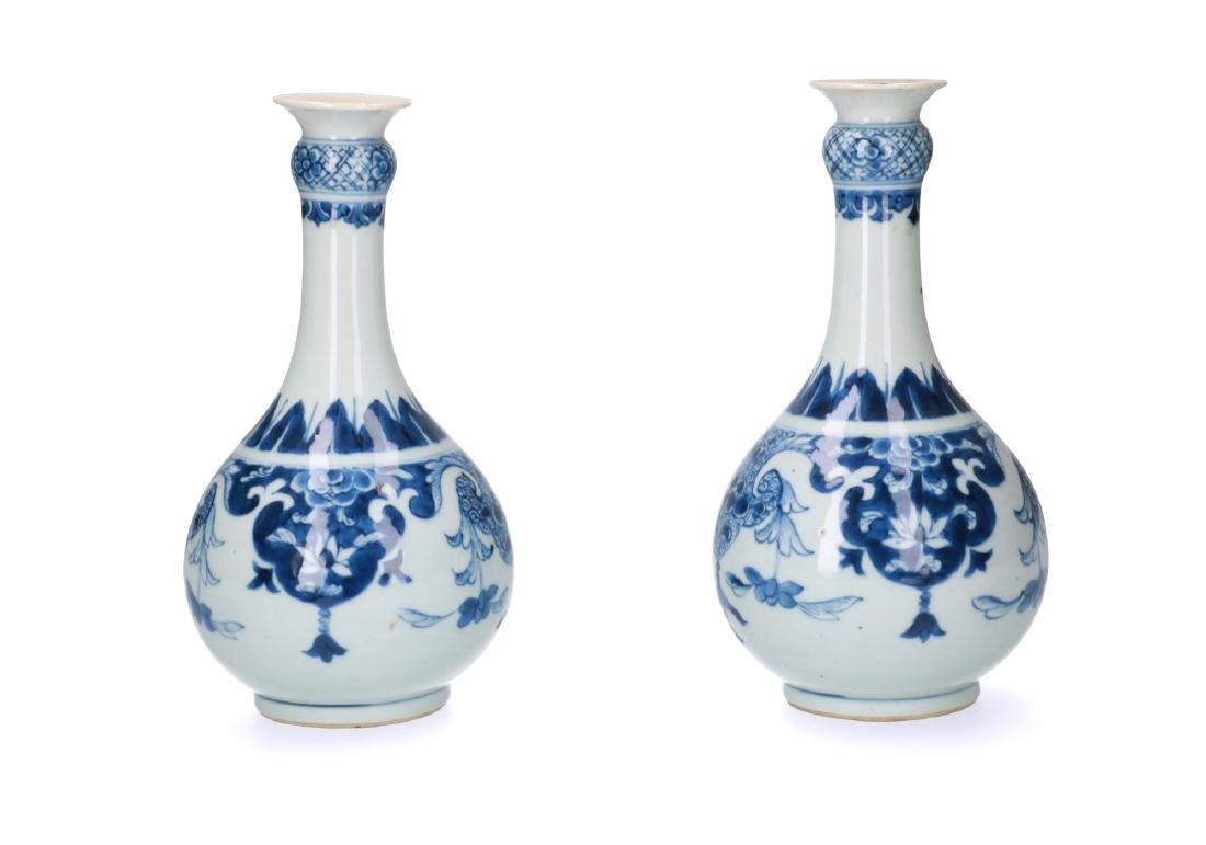A pair of blue and white porcelain bottleneck vases