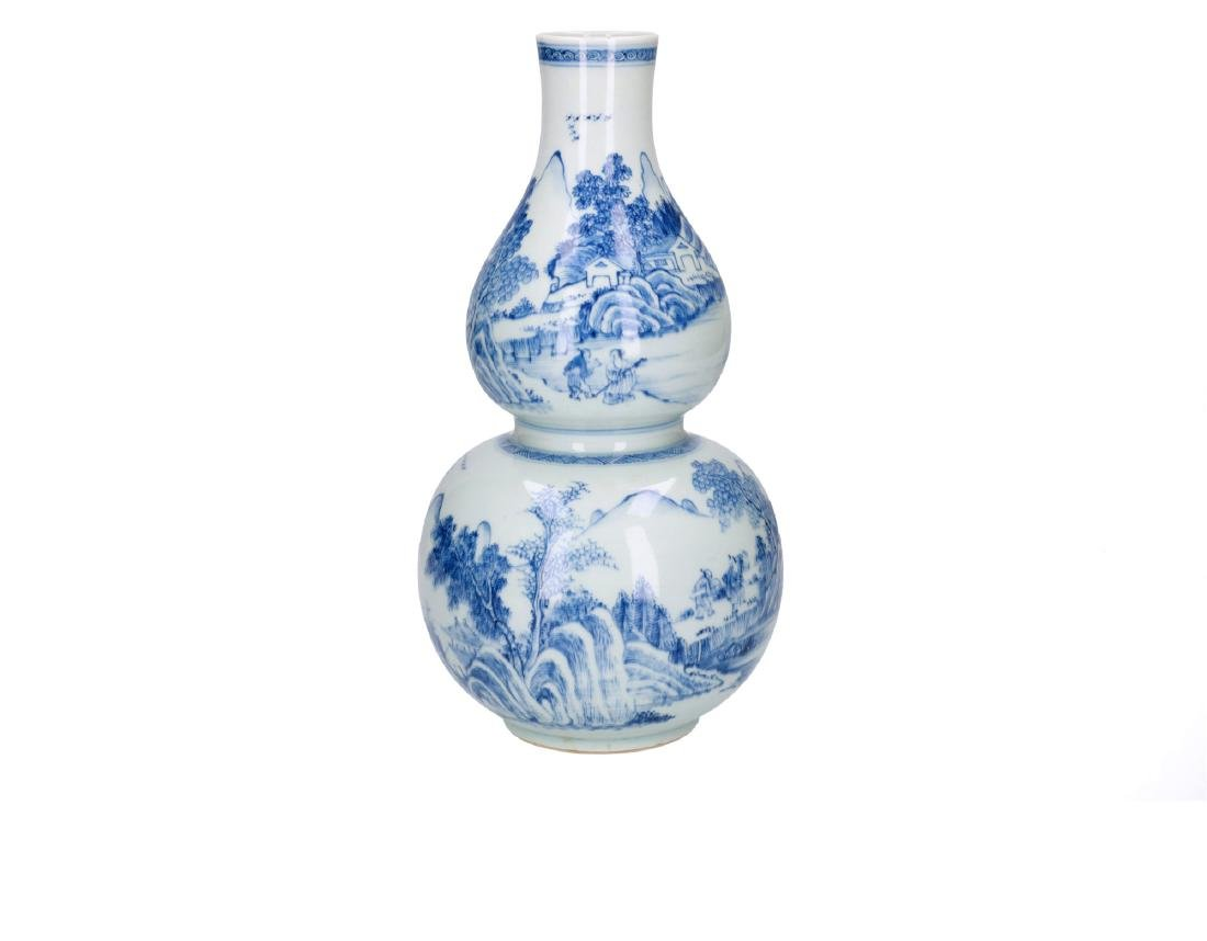A blue and white porcelain gourd vase, decorated with