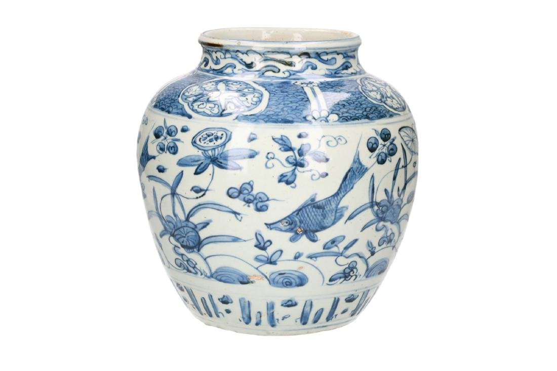 A blue and white porcelain jar decorated with carps and