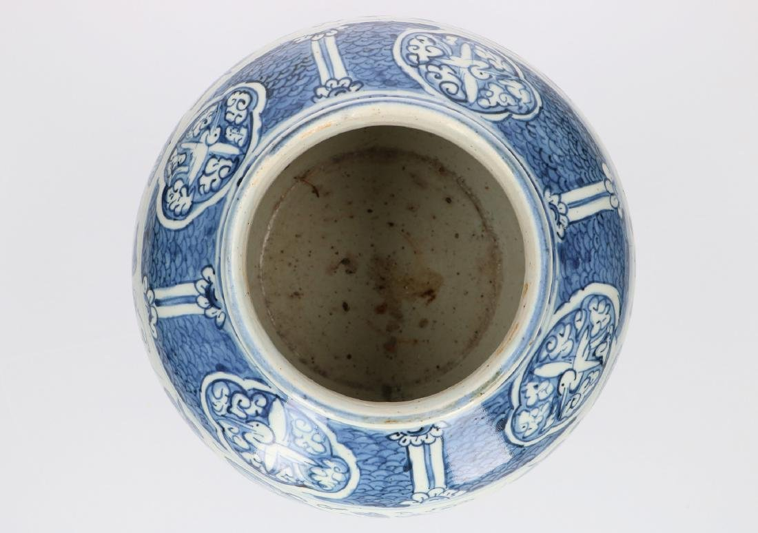 A blue and white porcelain jar decorated with carps and - 4