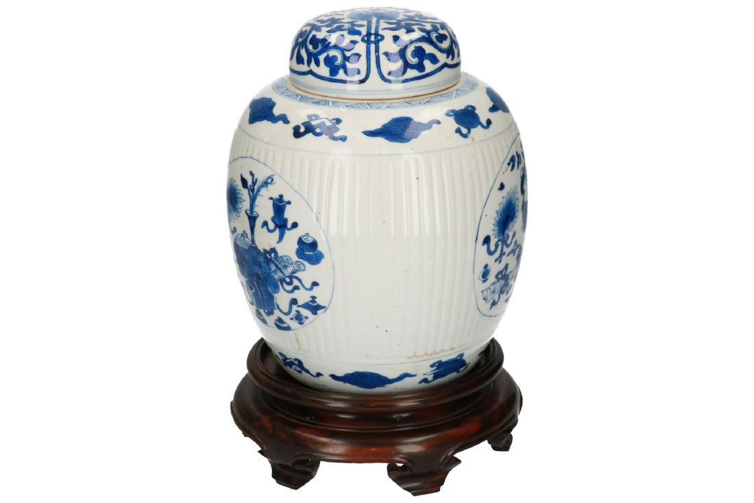 A blue and white porcelain ribbed lidded jar on wooden - 2