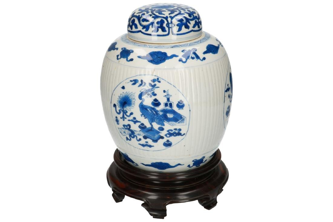 A blue and white porcelain ribbed lidded jar on wooden - 3