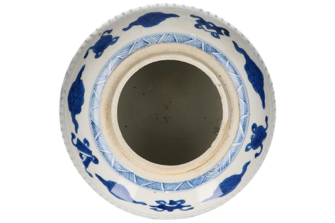 A blue and white porcelain ribbed lidded jar on wooden - 5