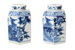 A pair of blue and white porcelain lidded ginger jars,