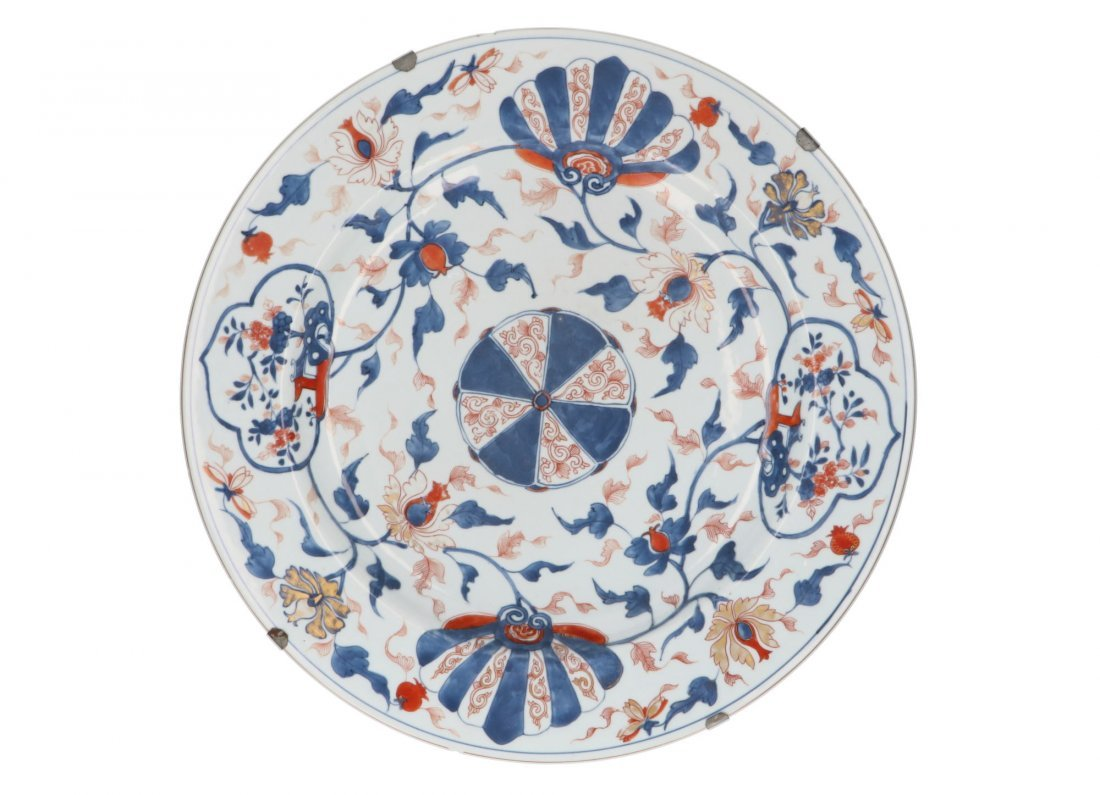 A porcelain charger with floral decor. Unmarked. China,