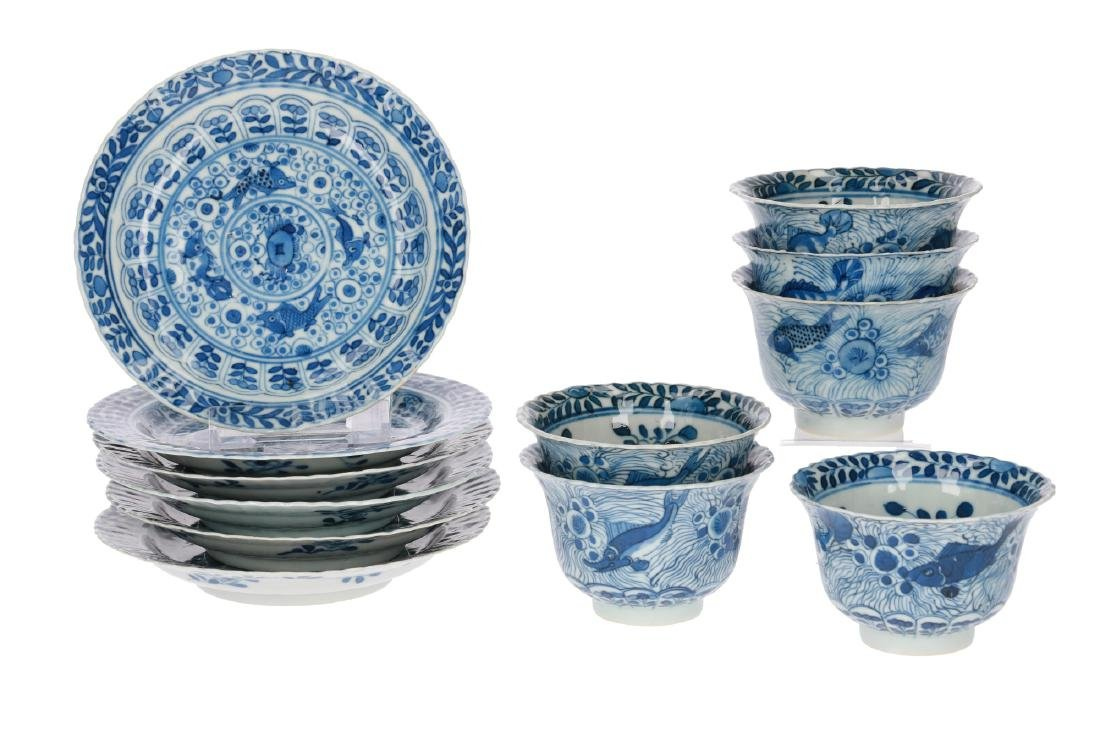 A set of six blue and white porcelain cups with saucers