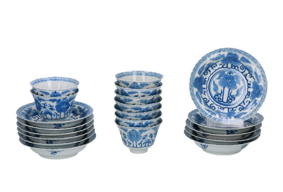 A lot of nine blue and white porcelain cups with eleven
