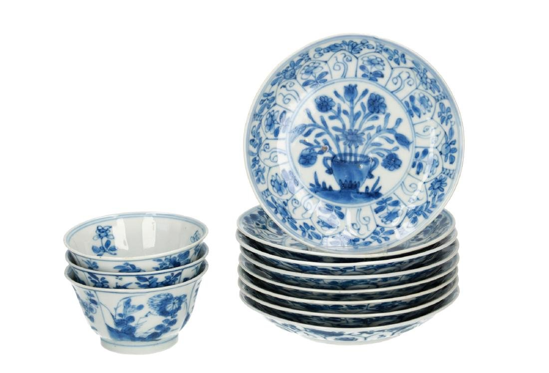 A set of three blue and white porcelain cups with eight