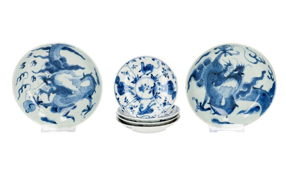 A set of four blue and white porcelain saucers,