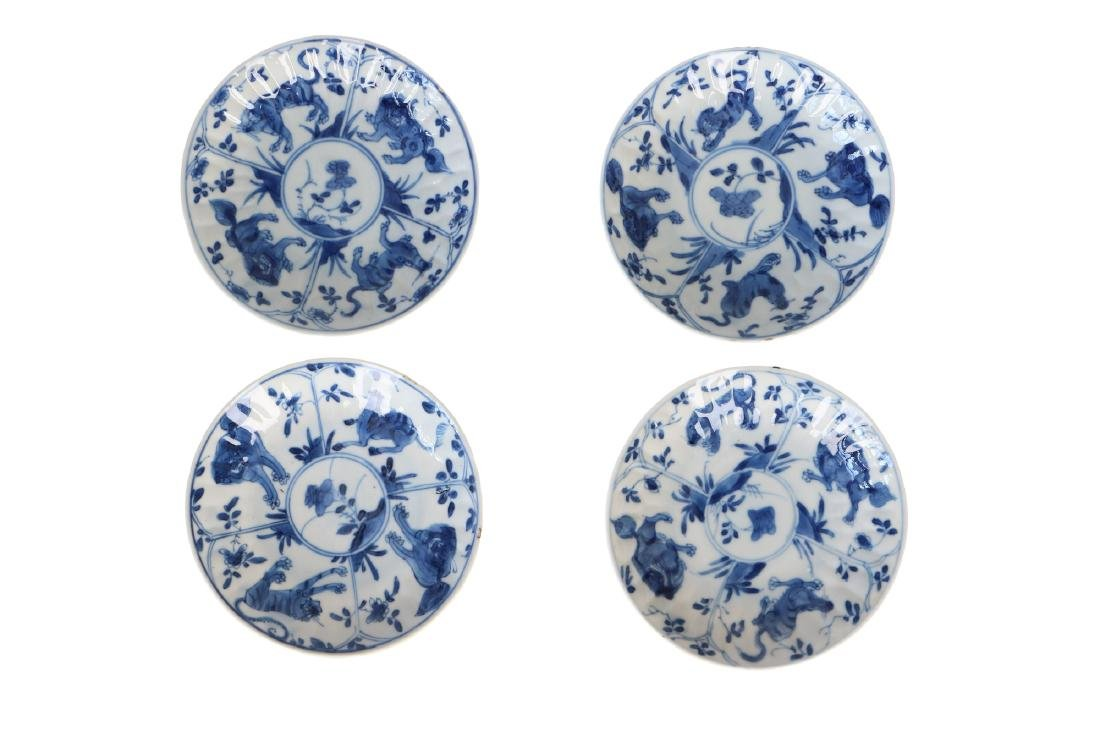 A set of four blue and white porcelain saucers, - 3