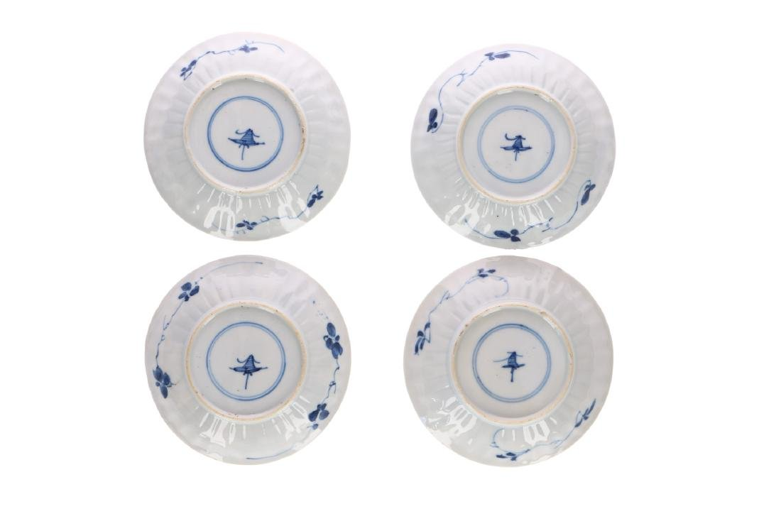A set of four blue and white porcelain saucers, - 4